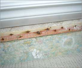 Rusted tack strip, an indicator of moisture and mold